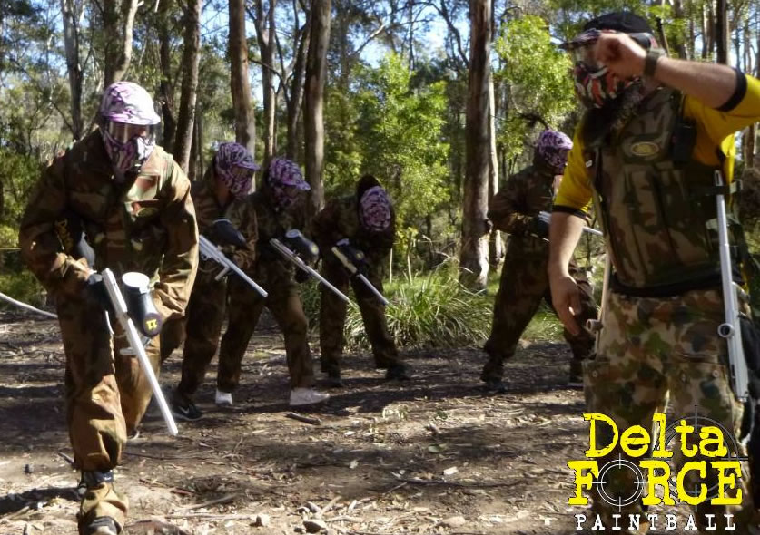 Players group playing at Delta Force Paintball